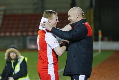 Cliftonvilles' George McMullan shares a hug with Manager Gerard Lyttle in action at Solitude in Belfast for the George McMullan Testimonial on April 11, 2016 Belfast, Northern Ireland ( Photo by Kevin Scott / Presseye )