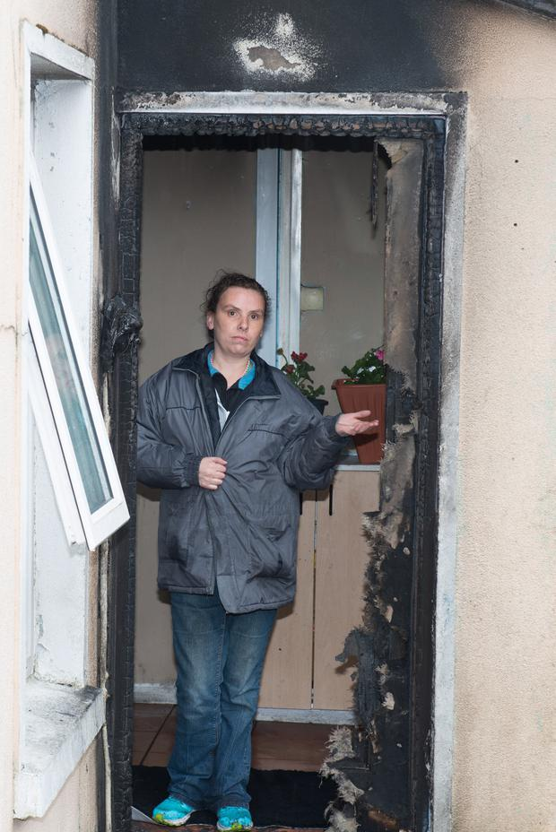 Lena Stokes at door of the door at the Stokes' family home in Drumard Park in the Hazelbank area of which was at the centre of an arson attack in the early hours of Tuesday morning. Picture Martin McKeown. Inpresspics.com.