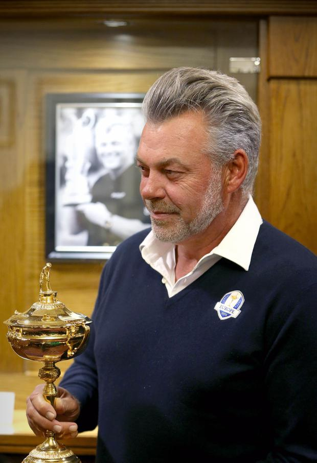 Picture credit © Matt Mackey - Presseye.com Belfast - Northern Ireland - 12th April 2016 European Ryder Cup captain Darren Clarke and the Ryder Cup trophy pictured at Royal Portrush GC in Co. Antrim. The Ryder Cup Trophy Tour will continue on Wednesday 13th April, Northern Irish golf fans will have the opportunity to get up close and personal to the famous trophy, when it is put on public display at City Hall in Belfast (from 9.00am ­ 10.30am) and The Dome at Victoria Square (from 11.00am ­ 9.00pm). Fans will have the opportunity to be photographed alongside the trophy free of charge ­ and pledge their support to the European team through social media.