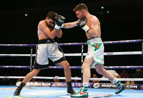 First to the punch: Conrad Cummings on way to victory over Victor Garcia in February at the Manchester Arena