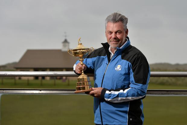 Royal visitors: European captain Darren Clarke with the Ryder Cup at Royal Portrush yesterday