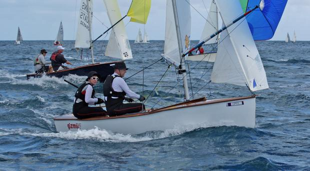 Winning partnership: Brenda Preston helming her GP14 'Gizmo' during one of the World Championship races in Barbados with husband Steven Preston crewing