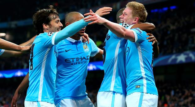 MANCHESTER, UNITED KINGDOM - APRIL 12: Kevin de Bruyne of Manchester City (R) celebrates with team mates as he scores their first goal during the UEFA Champions League quarter final second leg match between Manchester City FC and Paris Saint-Germain at the Etihad Stadium on April 12, 2016 in Manchester, United Kingdom. (Photo by Alex Livesey/Getty Images)
