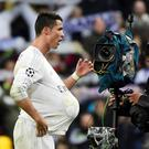 TOPSHOT - Real Madrid's Portuguese forward Cristiano Ronaldo celebrates his hat trick. Getty Images