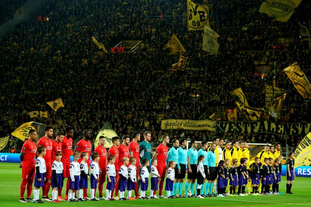 Borussia Dortmund and Liverpool line up before the start of the UEFA Europa League Quarter Final, First Leg match at Signal Iduna Park, Dortmund. PA