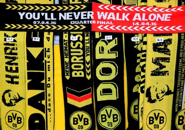 Liverpool and Borussia Dortmund scarves on sale outside the ground before the UEFA Europa League Quarter Final, First Leg match at Signal Iduna Park, Dortmund. PA