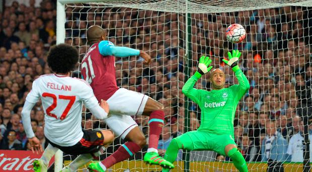 Manchester United's Belgian midfielder Marouane Fellaini (L) has a shot saved by West Ham United's Irish goalkeeper Darren Randolph during the FA cup quarter final replay football match between West Ham United and Manchester United at the Boleyn ground in London on April 13, 2016. / AFP PHOTO / GLYN KIRKGLYN KIRK/AFP/Getty Images