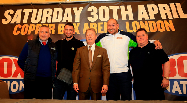 Heavy hitters: Peter Fury, Hughie Lewis Fury, Frank Warren, Tyson Fury and Mick Hennessy pose for a picture during a boxing press conference at the Landmark Hotel in London