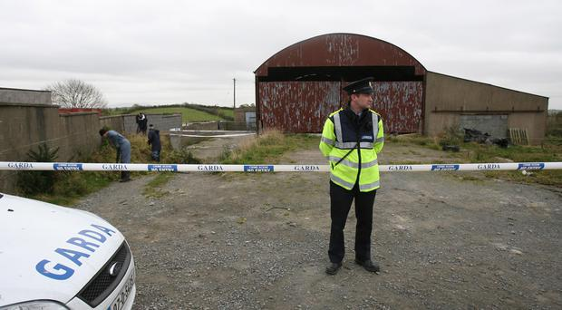 Garda at the scene of the dig. Pic Colm Lenaghan / Pacemaker