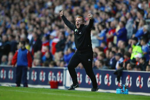 Caught in moment: Neil Lennon knows what it's like to be the centre of attention in an Old Firm derby