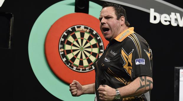 Darting spectacular: Nine-dart hero Adrian Lewis thrills the big crowd at the SSE Arena last night