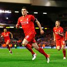 Mission impossible accomplished: Dejan Lovren heads for the Kop as team mates Daniel Sturridge and Philippe Coutinho set off in celebratory pursuit following the defender's dramatic last-gasp winner in last night's thrilling comeback triumph over Borussia Dortmund