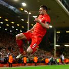 Final blow: Dejan Lovren and Liverpool hit the heights