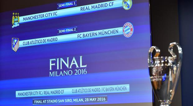 A screen displays the clubs that will be facing each other during the semi-final draw for the UEFA Champions League at the UEFA headquarters in Nyon on April 15, 2016. AFP PHOTO / FABRICE COFFRINIFABRICE COFFRINI/AFP/Getty Images