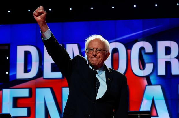 US Democratic presidential candidate Bernie Sanders waves as he arrives on stage for the CNN Democratic Presidential Debate at the Brooklyn Navy Yard on April 14, 2016, in New York. AFP/Getty Images