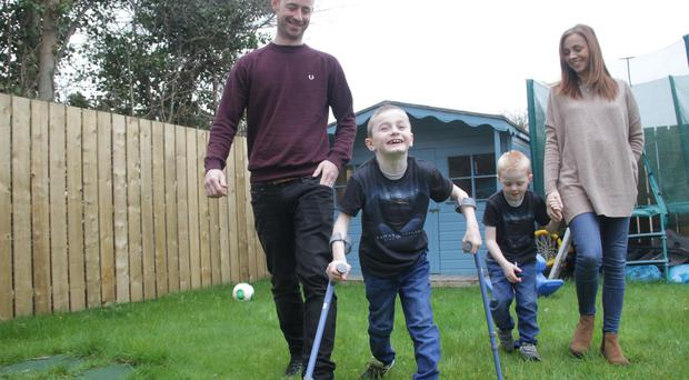 Oliver Dickey with mum Charlene, dad Neil and brother Max. Pic: Colm O'Reilly/Sunday Life.