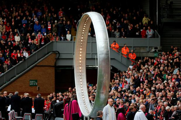 LThe 'Eternal Ring' is seen as Liverpool FC fans sing 'You'll Never Walk Alone' during a memorial service to mark the 27th anniversary of the Hillsborough disaster, at Anfield stadium on April 15, 2016 in Liverpool, England. (Photo by Christopher Furlong/Getty Images)