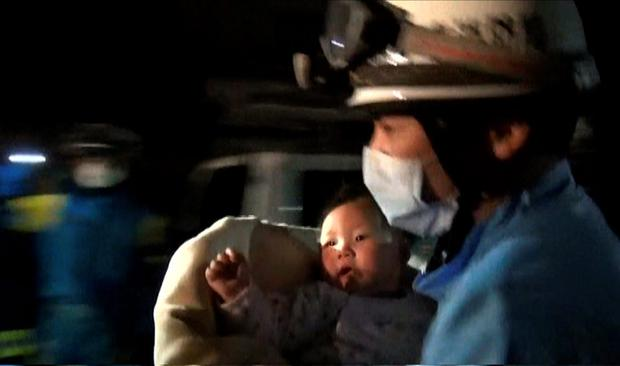 Image taken from video footage released by the Kumamoto Prefectural Police on April 15, 2016 shows a rescue worker carrying an eight-month-old baby girl after she was pulled from the rubble following an earthquake in Mashiki, Kumamoto Prefecture. Photo: Kumamoto Prefectural Police/AFP/Getty Images