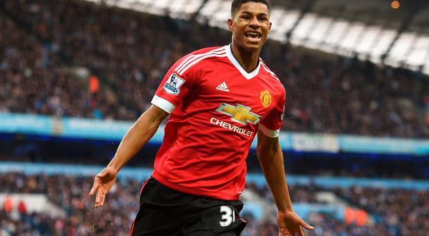 Baby faced assassin: Young hotshot Marcus Rashford has been thrust into the spotlight at Old Trafford