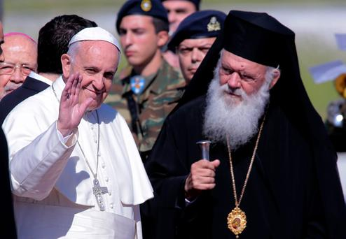 Pope Francis is met by Archbishop of Athens and All Greece, Ieronimos II as he arrives on the Greek island of Lesbos at Mytilene airport on April 16, 2016 in Mytilene, Lesbos, Greece. Pope Francis will visit migrants at the Moria camp on the Greek island of Lesbos along with Greek Orthodox Ecumenical Patriarch Bartholomew I and Archbishop of Athens and All Greece, Ieronimos II. (Photo by Milos Bicanski/Getty Images)