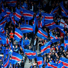 Rangers fans wave flags ahead of the William Hill Scottish Cup semi final between Rangers and Celtic at Hampden Park on April 17, 2016 in Glasgow, Scotland. Photo by Jeff J Mitchell/Getty Images