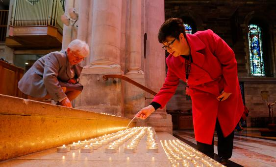 Congregation members light one of the thousand lights lit to commemorate the 75th anniversary of the Belfast Blitz held at St Anne's Cathedral, Belfast on April 17, 2016. Photo by Kevin Scott / Presseye