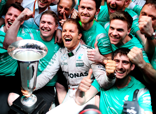 Number one: Nico Rosberg and his Mercedes team celebrate after winning the Formula One Grand Prix of China at Shanghai