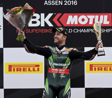 Top step: Ulsterman Jonathan Rea takes to the podium after extending his World Superbike title lead with yet another double triumph at Assen