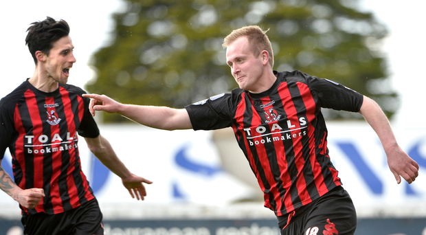 Decisive impact: Jordan Owens celebrates his winner against Glenavon, putting the Crues on the brink of back-to-back titles