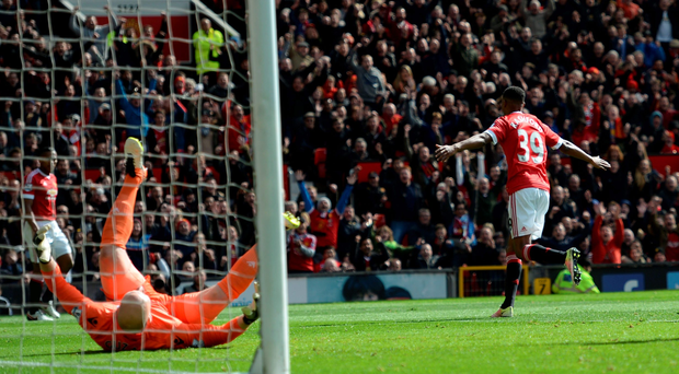 Goal-den boy: Manchester United striker Marcus Rashford hits the goal that relegated Aston Villa at Old Trafford