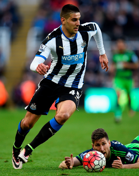Top gear: Newcastle's Aleksander Mitrovic races past Federico Fernandez
