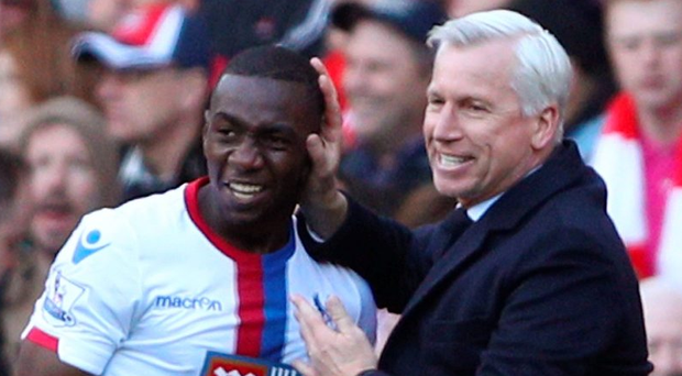 Drawing comfort: Yannick Bolasie of Crystal Palace celebrates scoring his team's equaliser against Arsenal with his manager, Alan Pardew