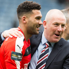 Cup joy Mark Warburton and Wes Foderingham celebrate