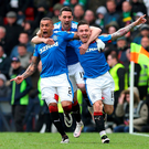 Power of three: James Tavernier, David Templeton and Barrie McKay celebrate the latter's goal at Hampden Park