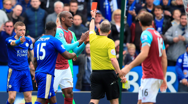 Jamie Vardy (centre) reacts after being sent off for a second yellow card