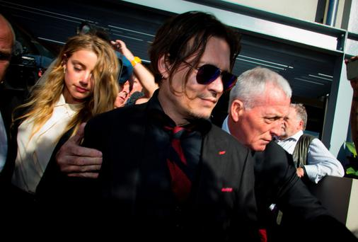US moviestar Johnny Depp and his wife Amber Heard leave the Gold Coast Courthouse. Pic: Getty Images