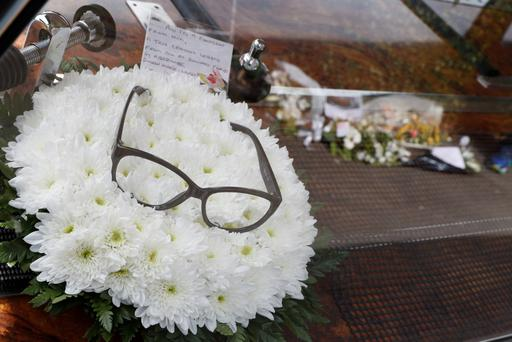A wreath with a note attached lies in the hearse carrying the coffin of British comedian Ronnie Corbett to his funeral in Croydon on April 18, 2016. Ronnie Corbett, one of Britain's most popular comedians, best known for