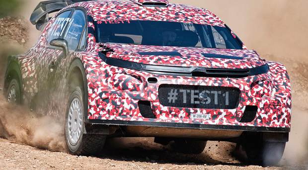 Out for a spin: Kris Meeke tests the new C3-based WRC Citroen, which is in pink camouflage livery to mask new features