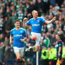 Jumping for joy: Kenny Miller celebrates his goal against Celtic at Hampden Park