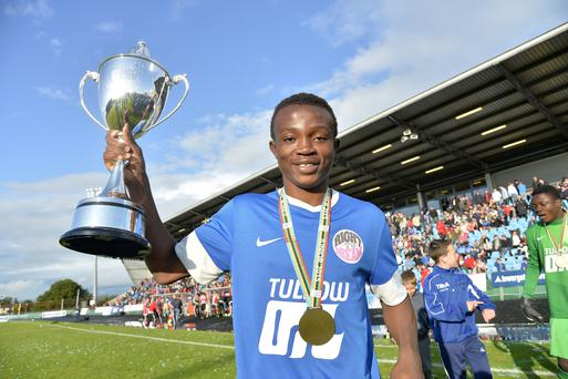 Prize guy: Right to Dream's Isaac Atanga lifts the Junior title at the 2015 Milk Cup, now rebranded the SuperCupNI