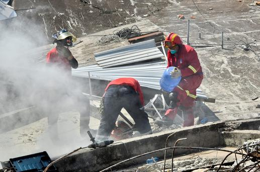 Peruvian rescuers take part in the search for survivors in Manta, in the Ecuadorean coastal province of Manabi, on April 18, 2016 two days after a 7.8-magnitude quake hit the country. AFP/Getty Images