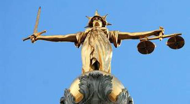 A member of a female Romanian shoplifting gang which hit shops in Coleraine was wearing a pair of baggy tracksuit bottoms tied tightly at the knees underneath a long skirt as a place to conceal goods, a court has heard