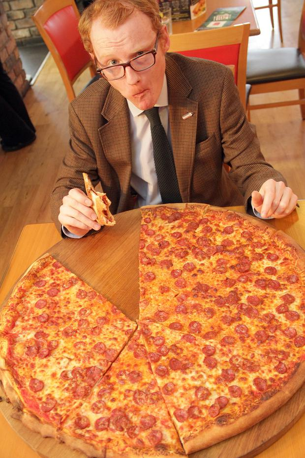 Say Cheese: Christopher gets stuck in to the 3.5 square foot pizza. Pic: Colm O'Reilly/Sunday Life.