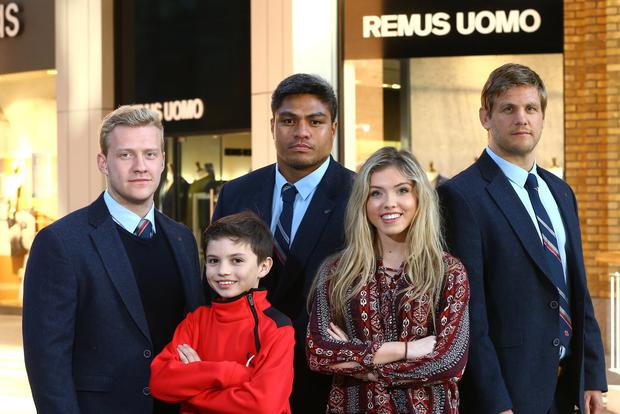 Dressed to impress: Chris Henry, Nick Williams and Stuart Olding with Ulster fans Ryan Cowden (10) and Amy McGuckin (18) at Remus Uomo Meet the Players event at Victoria Square