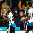 Vurnon Anita (L) of Newcastle United celebrates after scoring a goal to level the scores at 1-1 during the Barclays Premier League match between Newcastle United and Manchester City at St James' Park on April 19, 2016 in Newcastle, England. (Photo by Michael Regan/Getty Images)