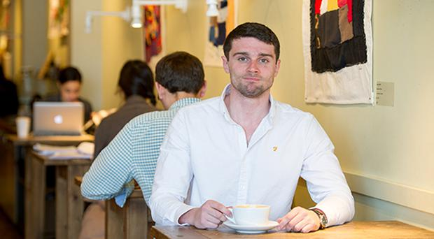 Leo Mcgann (CFA'17) is a playwriting MFA student who has just won a prestigious honor from the Kennedy Center - bringing him to a weeklong workshop there. His winning play is about the Irish troubles and how old wounds are dangerously reopened by a project a lot like those BC oral histories. He was photographed at Pavement at 736 Commonwealth Avenue April 6, 2016. Photo by Cydney Scott for Boston University Photography