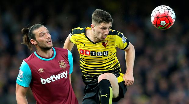Head high: Northern Ireland international Craig Cathcart tussles with West Ham striker Andy Carroll at Upton Park