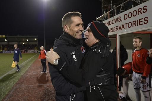 Glory boys: Crusaders manager Stephen Baxter celebrates at Solitude with his assistant Jeff Spiers