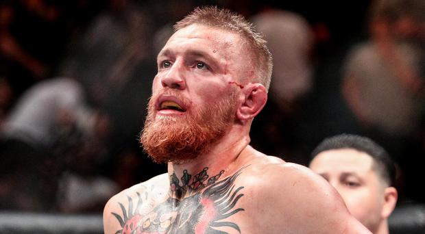 Hard to swallow: Conor McGregor after losing his fight against Nate Diaz in Las Vegas