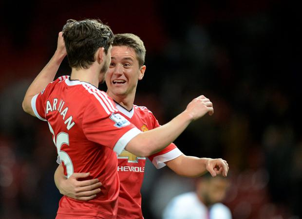 Manchester United's Italian defender Matteo Darmian (L) and Manchester United's Spanish midfielder Ander Herrera celebrate after winning the English Premier League football match between Manchester United and Crystal Palace at Old Trafford in Manchester, north west England, on April 20, 2016. / AFP PHOTO / OLI SCARFF / RESTRICTED TO EDITORIAL USE. No use with unauthorized audio, video, data, fixture lists, club/league logos or 'live' services. Online in-match use limited to 75 images, no video emulation. No use in betting, games or single club/league/player publications. / OLI SCARFF/AFP/Getty Images